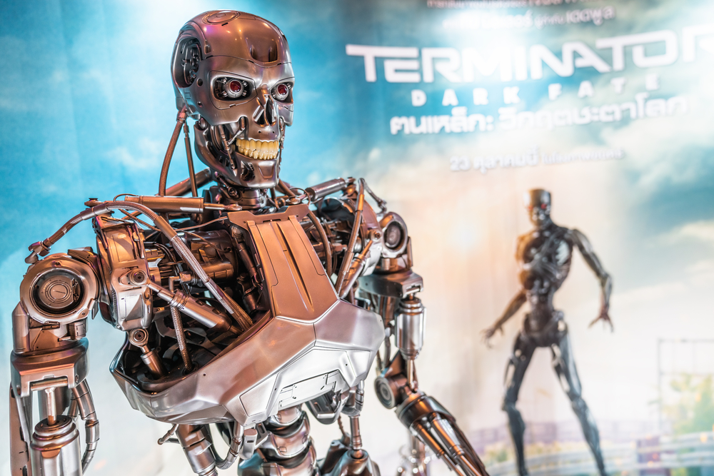 The terminator started as a machine programmed to kill. Later in the movies it developed awareness and consciousness as it spent more time with humans